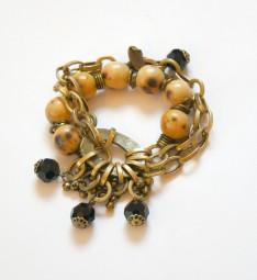 Fiva extravagantes Bronze-Holz-Armband